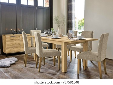 Elegant dining room design. Interior of dining room with table and chairs