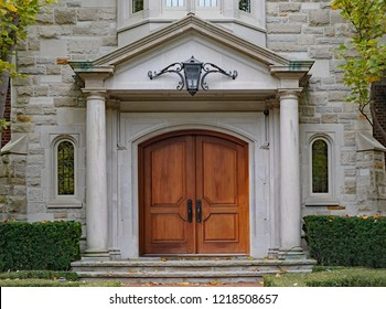 elegant double front door with stone columns