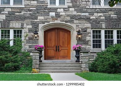 elegant double wooden front door  of upper class stone fronted house