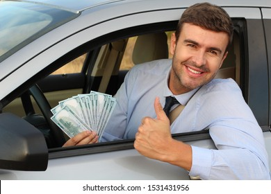 Elegant driver holding lots of dollars