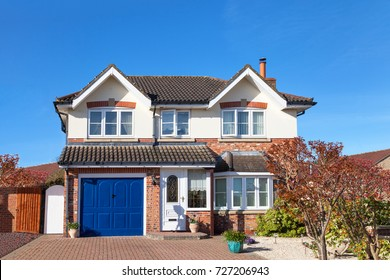 Elegant english house with blue garage door