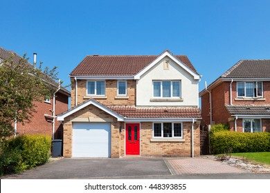 Elegant english house with red door