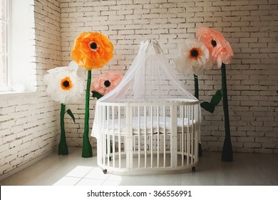 Elegant expensive bed for newborn baby. Luxury decorations of apartments