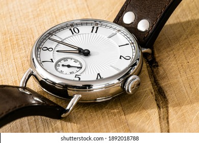 Elegant expensive men fashion no brand wrist watch with leather band on a rustic wooden table