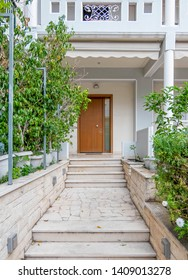 elegant family house entrance marble covered pathway and wooden door, Athens Greece