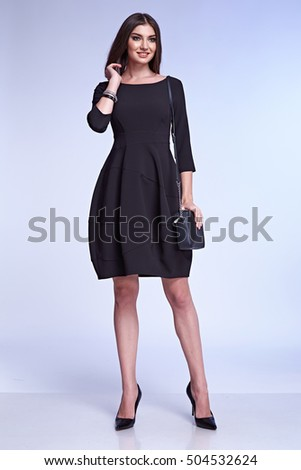 fe4845807e Elegant fashion glamour model pose for catalogue of business style clothes  woman wear office dress code black color for meeting and casual brunette  hair ...
