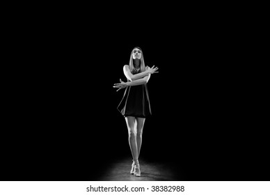 elegant fashion woman standing - isolated over black backgound