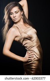 Elegant fashionable woman in golden dress