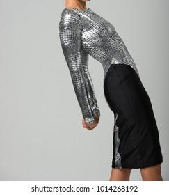 Elegant Female High Fashion Model in a Beautiful Silver Textured and Black Dress - Leaning Backward