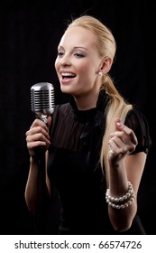 An elegant female singer with microphone