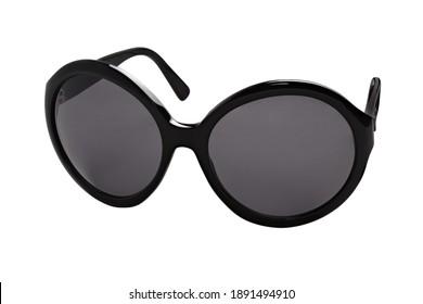 Elegant female sunglasses in black glossy plastic frames and dark lenses on a white background. Half-turn view.