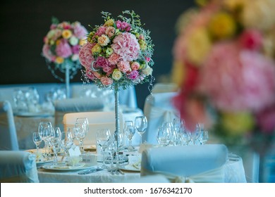 Elegant floral set up for an wedding event with candles lit
