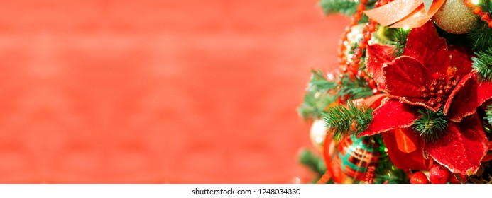 Elegant flower, made of fabric with sequins. New Year decoration for Christmas tree. Place for text.