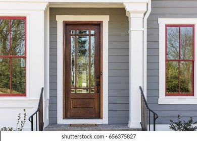 Elegant front door with iron railing