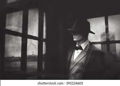 elegant gangster man behind window looking at the city