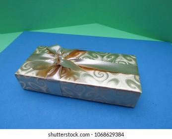 an elegant gift box over blue background