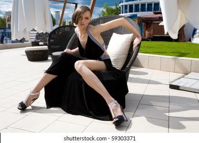 An elegant girl in a chair
