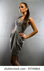 an elegant girl in grey dress