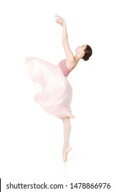 Elegant girl in a pink skirt and beige top dancing ballet. Studio shooting on white background, isolated images.