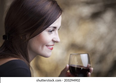 Elegant glamour woman in restaurant with glass of red wine