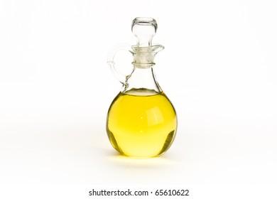 Elegant glass bottle of olive oil on white isolating background