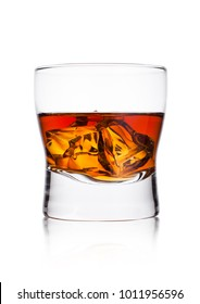 Elegant glass of whiskey with ice cubes on white background with reflection