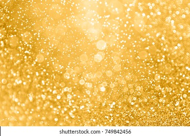 Elegant gold glitter sparkle confetti background for golden happy birthday party invite, 50th wedding anniversary, glitz and glam, glitzy coins, Christmas ad or New Year's Eve champagne color backdrop