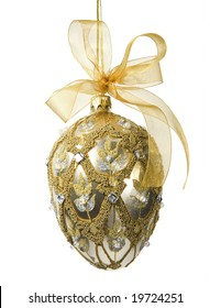 Elegant gold and silver bejeweled egg-shaped ornament with gold mesh bow (includes clipping path).