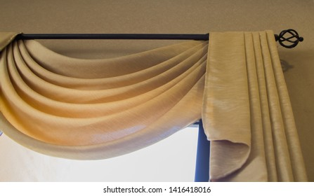 elegant golden curtain,blind is used to decorate the glass room.