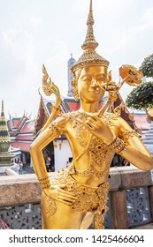 Elegant golden statue of Kinnari at Grand Palace, Bangkok, Thailand, mythological characters are the benevolent half-human, half-bird creatures. The Grand Palace is open to the public.