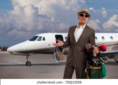 Elegant golfer in front of a corporate jet.