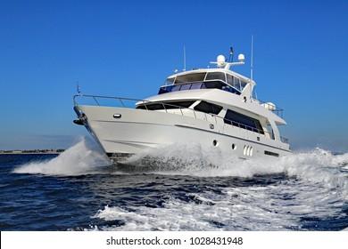 Elegant and graceful luxury power boat underway off Palm Beach, Florida