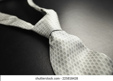 Elegant gray tie on a black background in the style fifty shades of gray - SOFT FOCUS