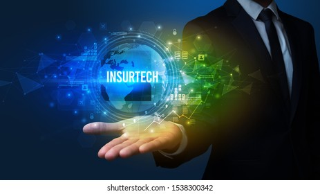 Elegant hand holding INSURTECH inscription, digital technology concept