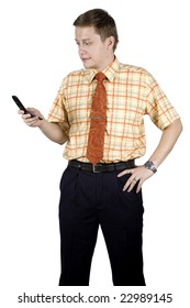 Elegant, handsome businessman busy with his mobile phone, wearing shirt and tie, friendly looks.
