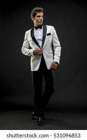 Elegant and handsome man dressed in tuxedo for New Year's Eve or party