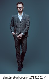 Elegant handsome man in spectacles and fashionable suit. Business style. Studio portrait.