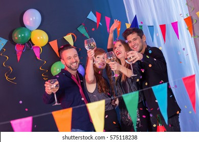 Elegant happy young people celebrating new year's eve on a party