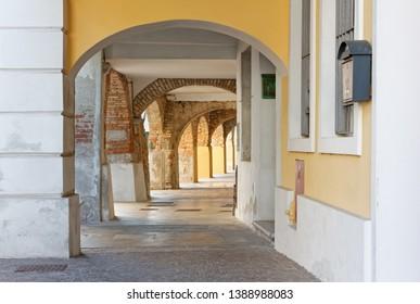 Elegant historic arcade in Aquileia, Italy