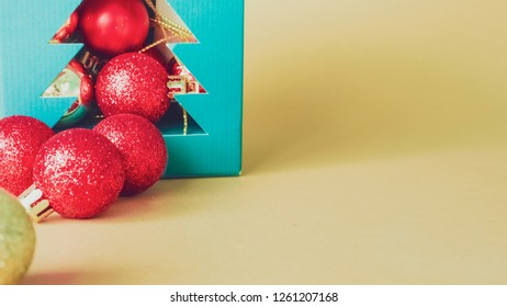 elegant holiday party event and celebration concept for shimmer and shine gold and red ball decorate on gold glitter and snow background