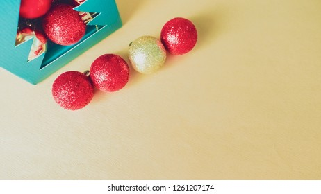 elegant holiday party event and celebration concept for shimmer and shine gold and red ball decorate on gold glitter background