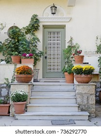 Elegant house entrance with lots of flower pots, Athens Greece