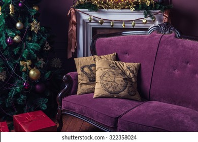 elegant interior Christmas decorations. Purple Sofa with two beige pillows stands next to a Christmas tree. Merry Christmas and happy New Year! A series of photos