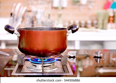 Elegant kitchen studio for the food business cooking in hotel have a equipment luxury and closeup pot on the gas stove which has fire.