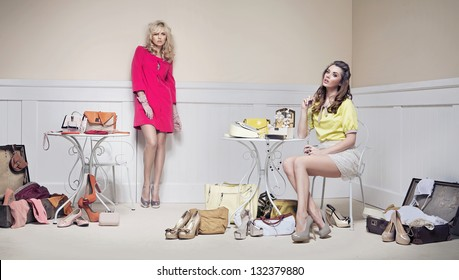 Elegant ladies in a room full of fashion accessories