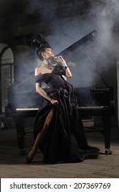 elegant lady in black dress with luxurious hairstyle  near piano