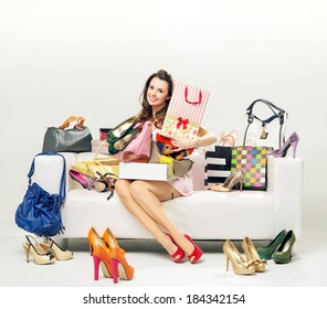 Elegant lady in a room full of fashion accessories