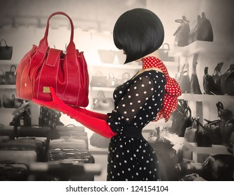 Elegant lady with stylish short hairstyle holding a bag