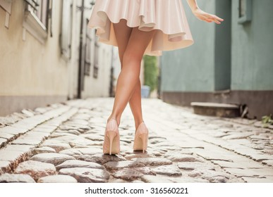 Elegant lady walking alone in the street