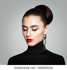 Elegant Lady. Woman with Retro Style Hairstyle and Eyeliner Makeup